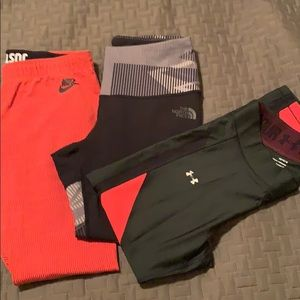 3 pairs leggings. Nike. Under Armour. North face.